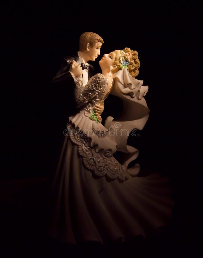 Wedding figurines on black