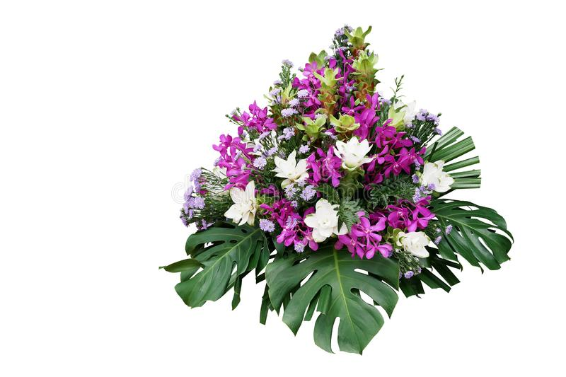 Wedding floral decoration with tropical foliage plants Monstera, fern, lady palm and exotic flowers purple orchids and Curcuma. Floral arrangement bouquet stock image