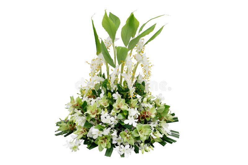 Wedding floral decoration with tropical green leaf plants and exotic flowers dancing lady ginger, white orchids and Curcuma, royalty free stock image