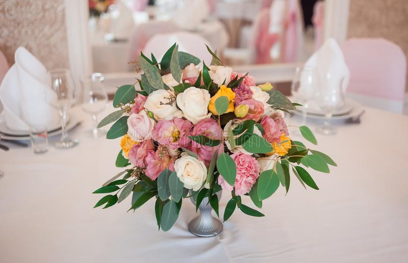 Wedding floristics. Decoration of a table fresh flowers. Wedding in pink color royalty free stock images