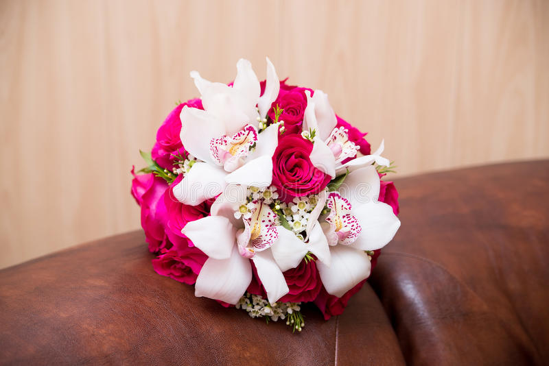 Wedding flower bouquet with pink roses and white callas. Indoor stock photography