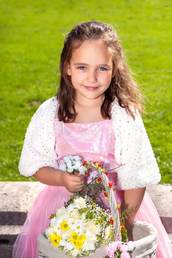 Wedding - Flower Girl. In a beautiful rosa dress stock photo