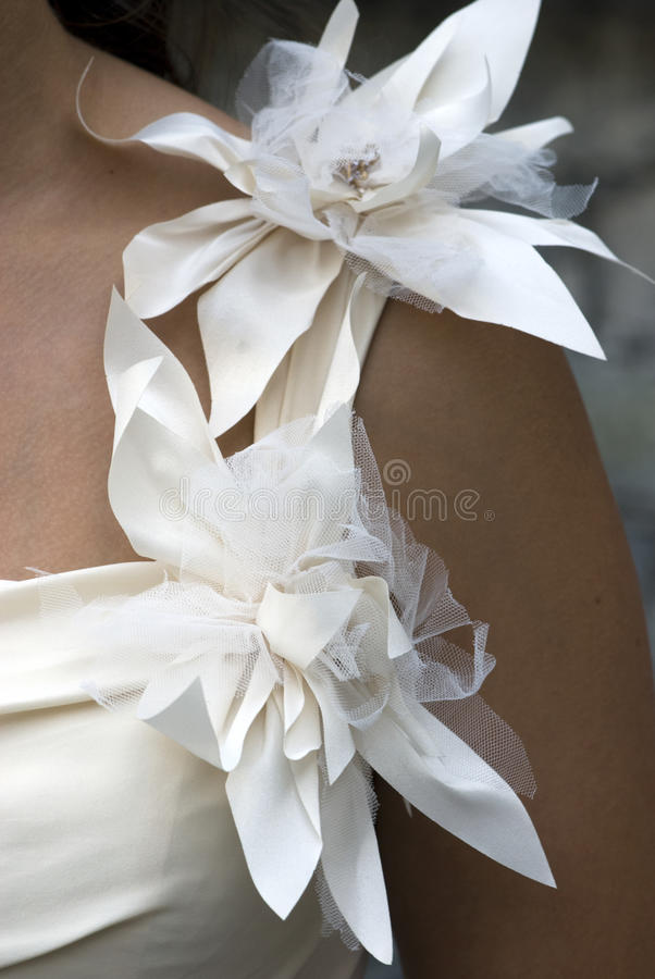 Wedding flowers. Wedding day - detail of bride dress stock image