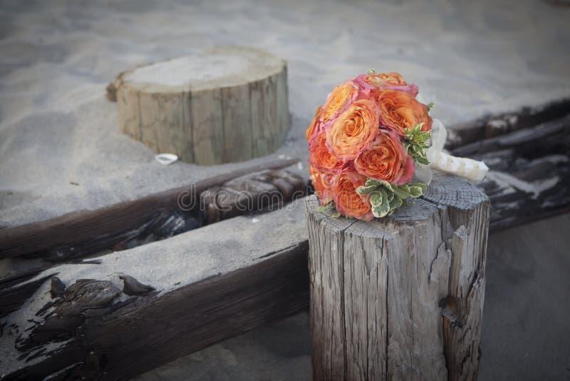 Wedding Flowers. On a beach, orange rozes stock image