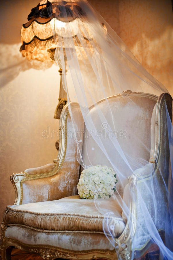 Wedding flowers. Bouquet of flowers and wedding on a chair royalty free stock image