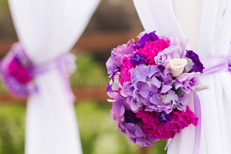 Wedding flowers. Raw of carnations balls as a wedding decor royalty free stock photo