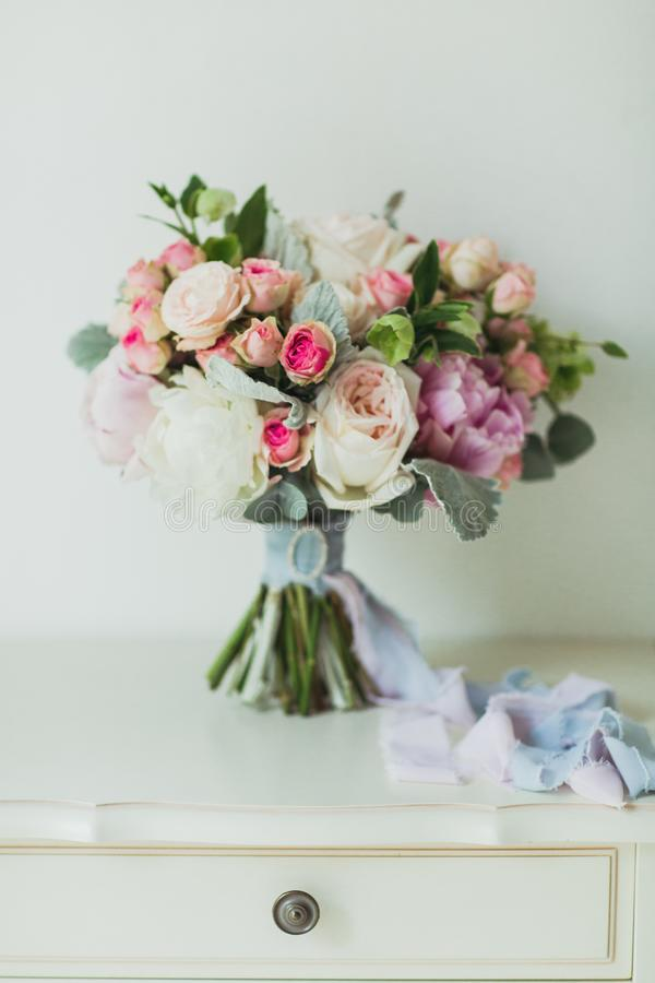 Wedding flowers bouqete on the nightstand royalty free stock photos