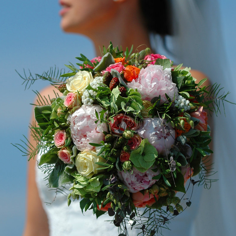 Wedding flowers and bride stock image