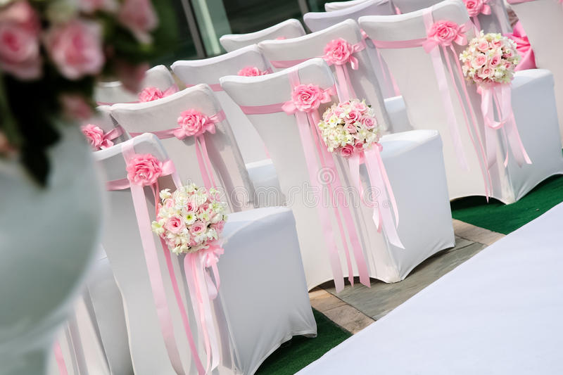 Wedding scene. Wedding flowers and chairs at outdoor wedding royalty free stock photo