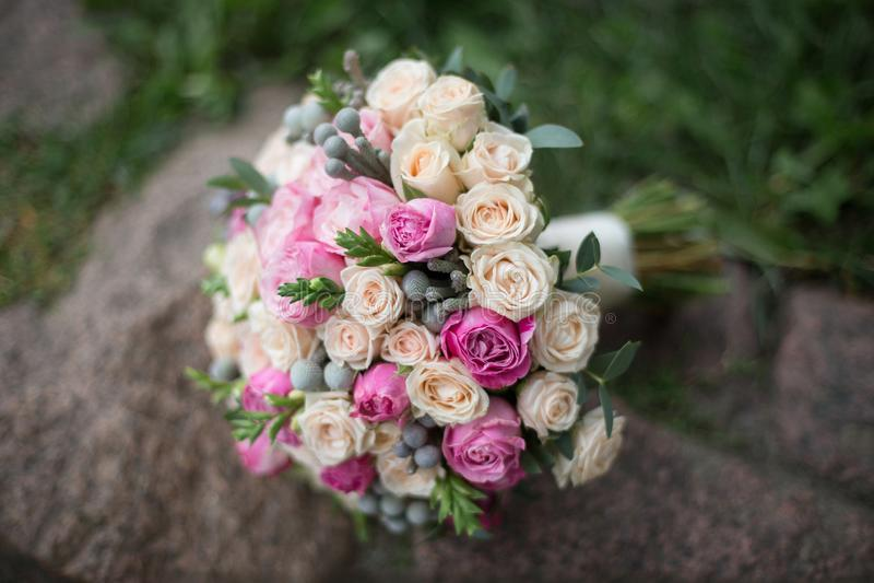 Wedding flowers. Delicate wedding bouquet on the stones stock image