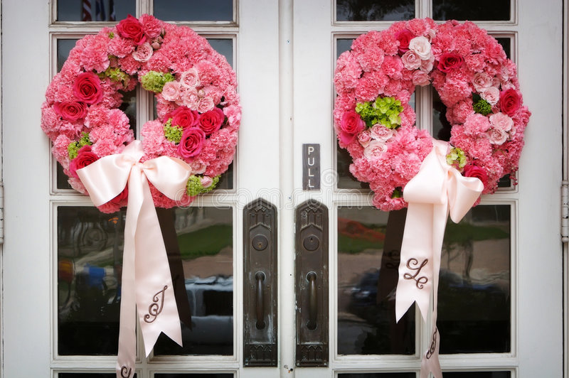 Wedding flowers on the front door of a church stock image