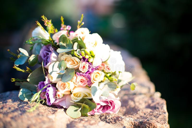 Wedding flowers on the stone, wedding decor stock photography