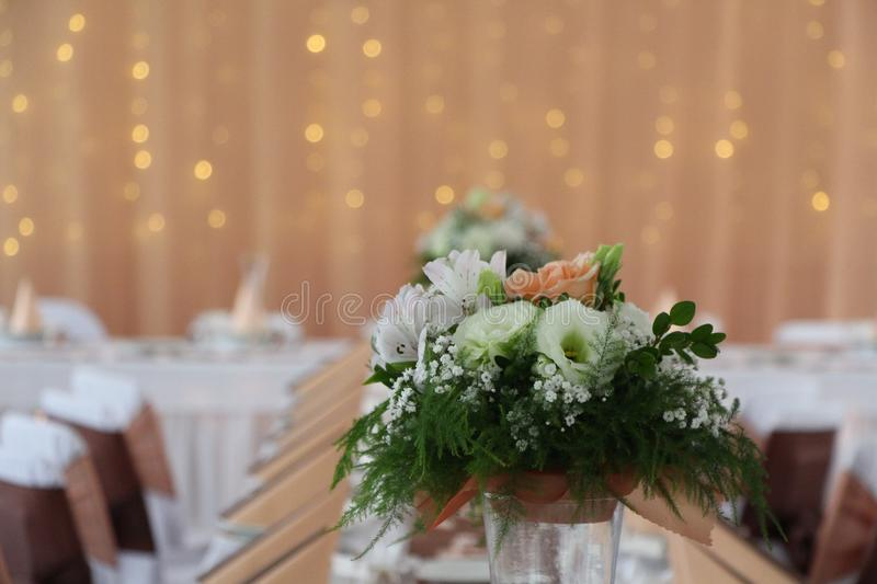 Wedding flowers in table on party stock image