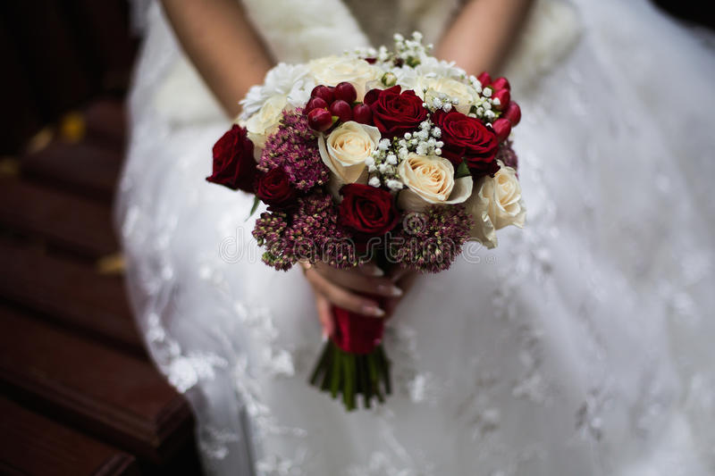 Wedding flowers, wedding bouquet, the bride holding a bouque stock photo