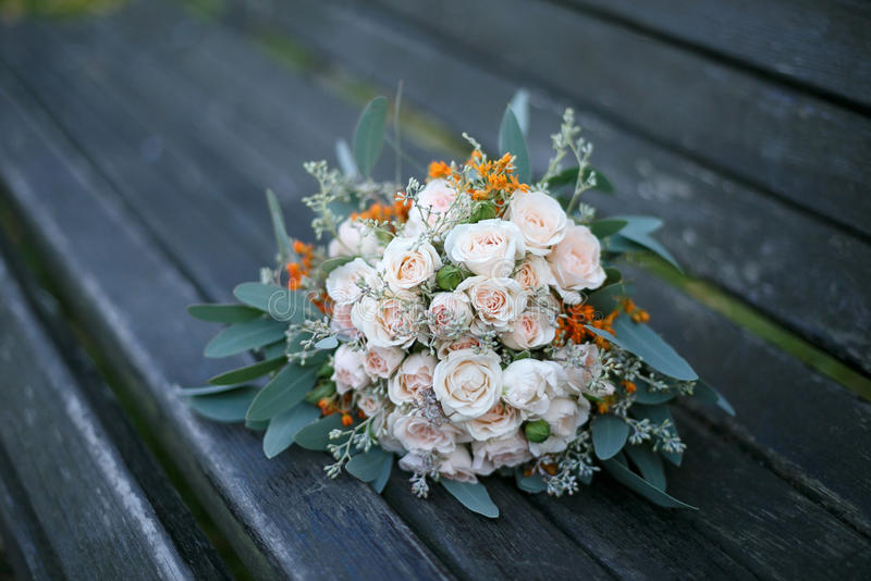 Wedding flowers. On a wooden bench royalty free stock photos