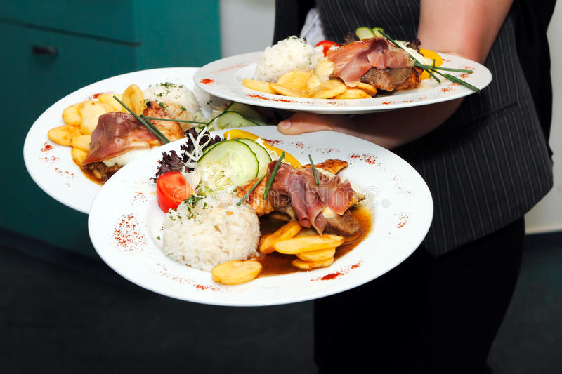 Wedding food being served. Food being served by a waiter during a wedding or catered social event stock images