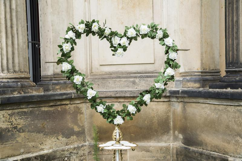 Wedding fresh wreath of white roses with green leaves stock image