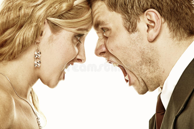 Wedding fury couple yelling, relationship difficulties. Wedding couple relationship difficulties. Angry women men yelling at each other. Portrait fury bride stock photos