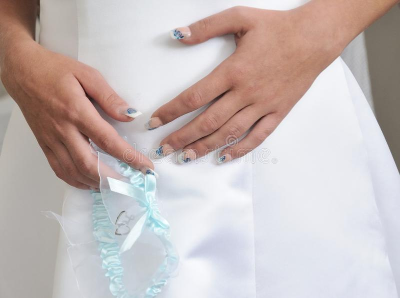 Download Wedding garter stock image. Image of hand, beautiful - 25600459