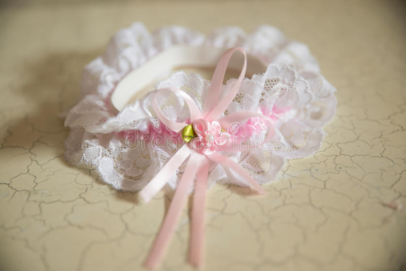 Wedding garter. Close-up details stock photo