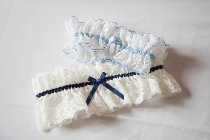 Wedding garter on white background. Wedding garter close-up details on white background waiting to by dressed royalty free stock image
