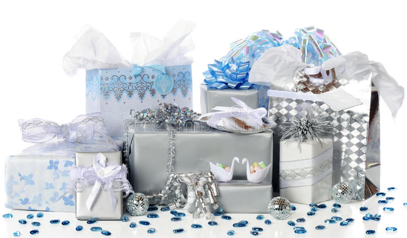 Wedding Gifts Galore. A variety of silver and blue-wrapped wedding (or 25th Anniversary) gifts sfptmrf with two tiny candy holding swans, 3 mirror balls, and stock images
