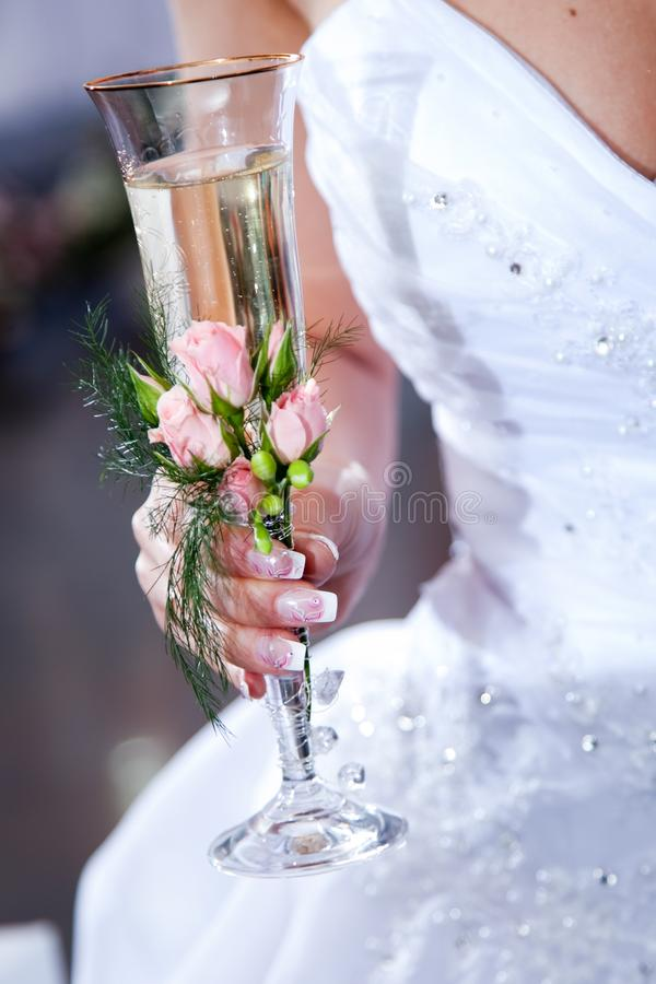 Wedding glass in hands of bride stock photography