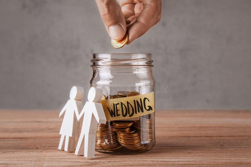 Wedding Glass Jar With Coins And An Inscription Is Wedding And