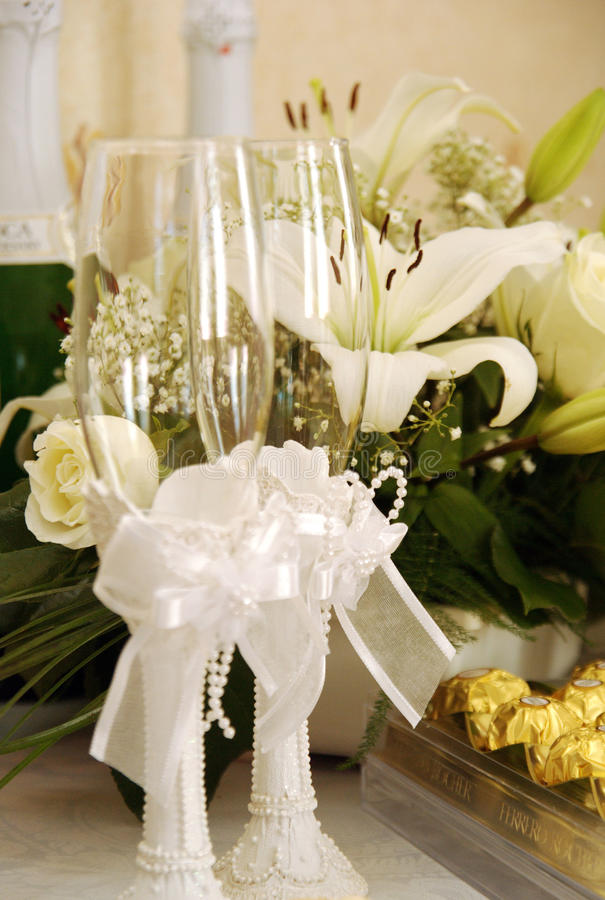 Wedding glasses. A pair of decorated wedding champagne glasses stock photos