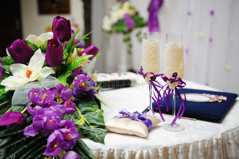 Wedding glasses and flowers. Wedding glasses of champagne and flowers on the table stock images