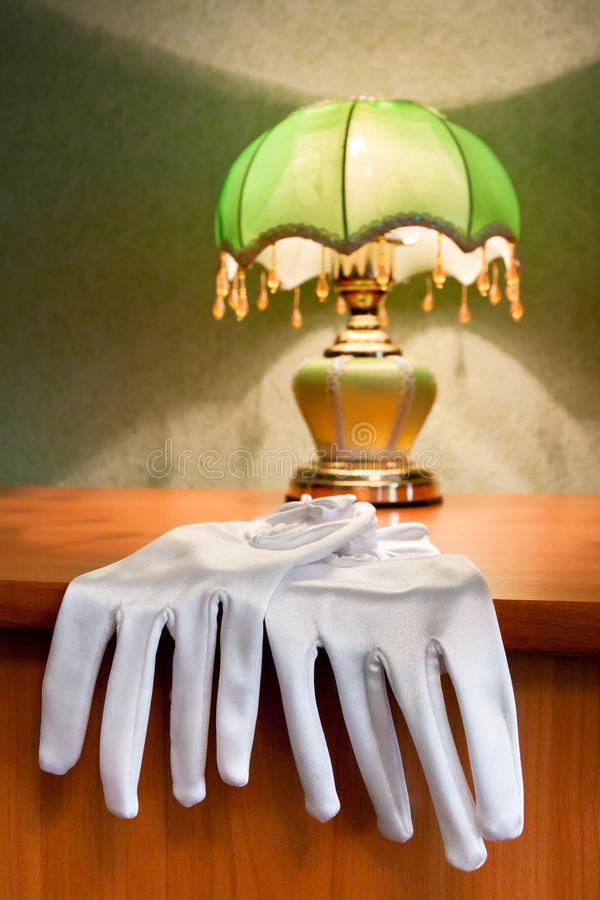 Wedding gloves on the table. Wedding gloves lying on the table royalty free stock photo