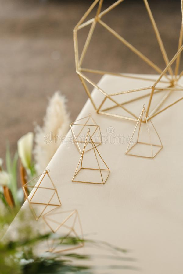 Wedding gold geometric decoration on the table stock photo