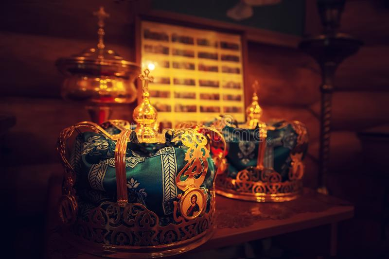 Wedding golden crowns for the marriage ceremony. In Orthodox church royalty free stock image