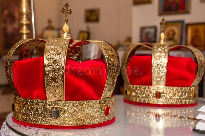 Wedding golden crowns. Ready for wedding ceremony in Serbian orthodox church royalty free stock images