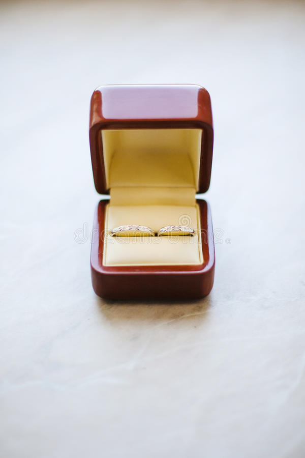 Wedding Golden Rings in red box on White. stock image