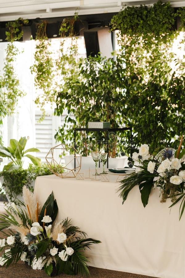 Wedding green altar.Served for wedding restaurant table stock photography