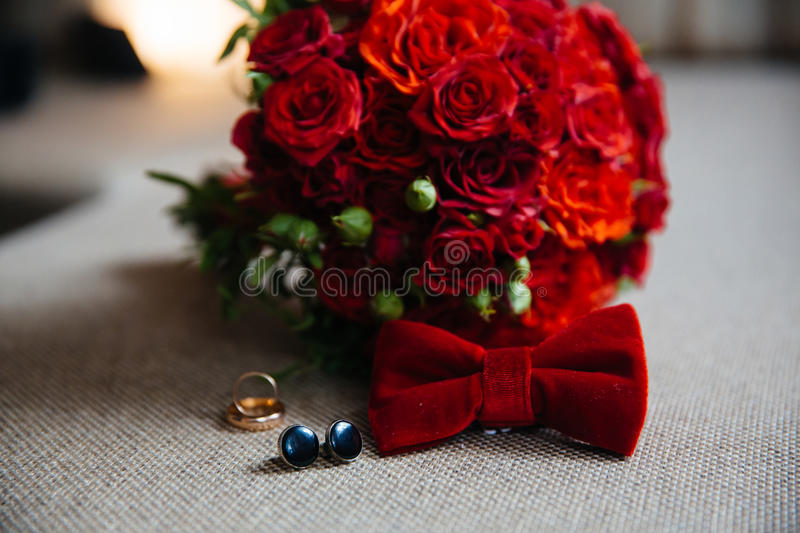 Wedding groom accessories, details of clothes, bow tie, cuff links, golden rings. stock image