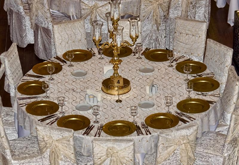 A wedding guest table in the process of getting ready for the ev royalty free stock photography
