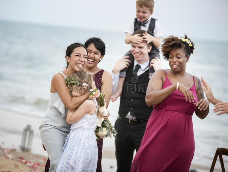 Wedding guests clapping for the bride and groom stock image