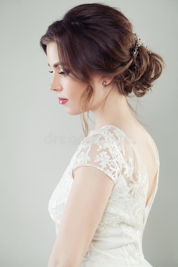 Wedding hair. Beautiful bride with makeup and bridal hairstyle, portrait royalty free stock images