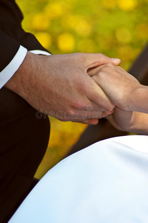 Wedding hands. Wedding Couple holding hands stock photo