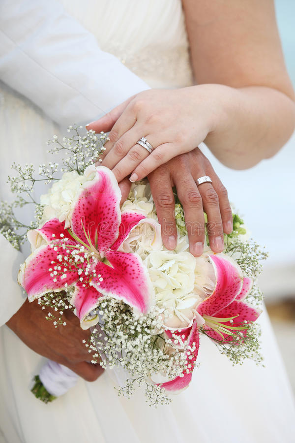 Wedding Hands and Rings on Bouquet - Tropical stock photos