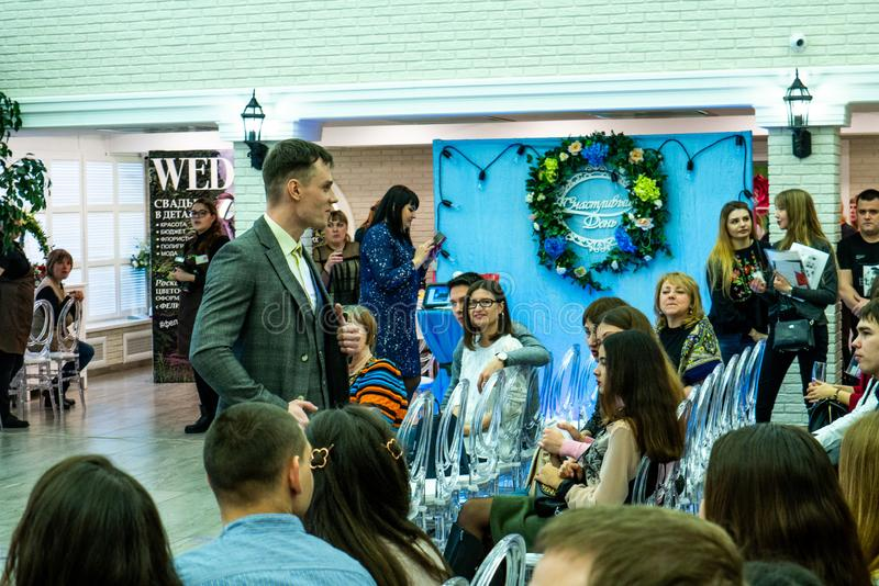 A groom model in a wedding suit at the wedding show. A groom model in a wedding suit at the wedding exhibition Wedding hassle 2019 took place in Kirov, Russia stock photo