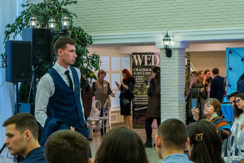 A groom model demonstrating a wedding suit. At the exhibition Wedding hassle 2019 took place in Kirov, Russia stock photos