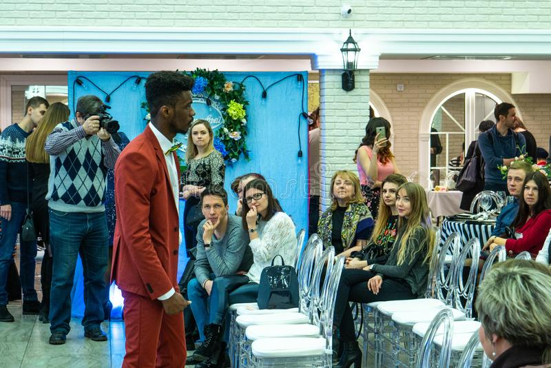 An afro-american groom model demonstraits a wedding suit to the guests. At the Wedding hassle 2019 exhibition took place in Kirov, Russia stock images
