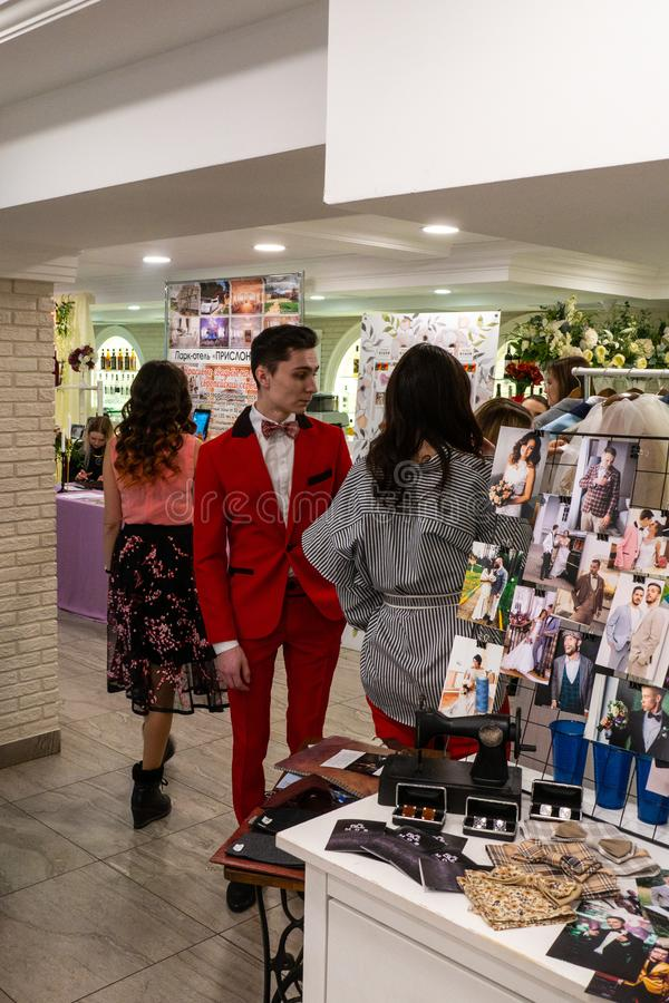 A modern stylish couple at the wedding exhibition. A modern stylish couple at Wedding hassle 2019 the wedding exhibition took place in Kirov, Russia royalty free stock photos