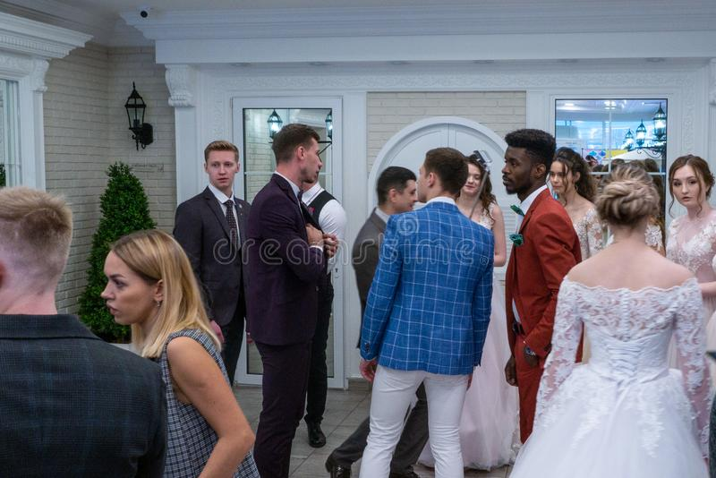 Models and wedding specialists talking to each other after party. At the Wedding hassle 2019 exhibition took place in Kirov, Russia stock photo