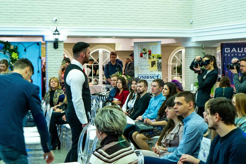 A groom model demonstrates a wedding suit to the guests. At the Wedding hassle 2019 exhibition took place in Kirov, Russia stock photography