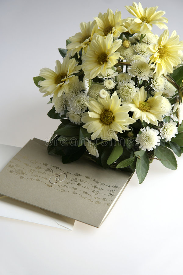 Wedding invitation. Picture of wedding invitation and flowers stock photo
