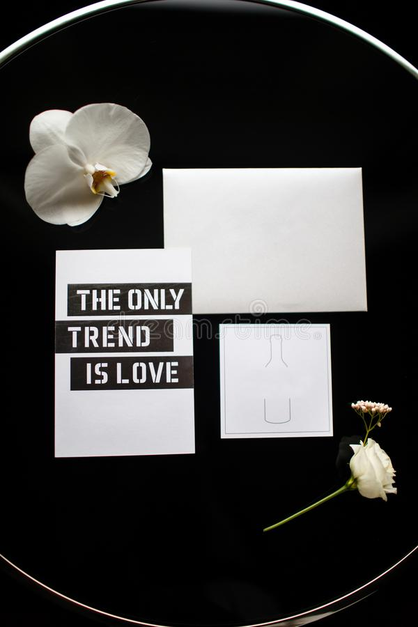 Wedding invitation card and orchid on a glass table stock images